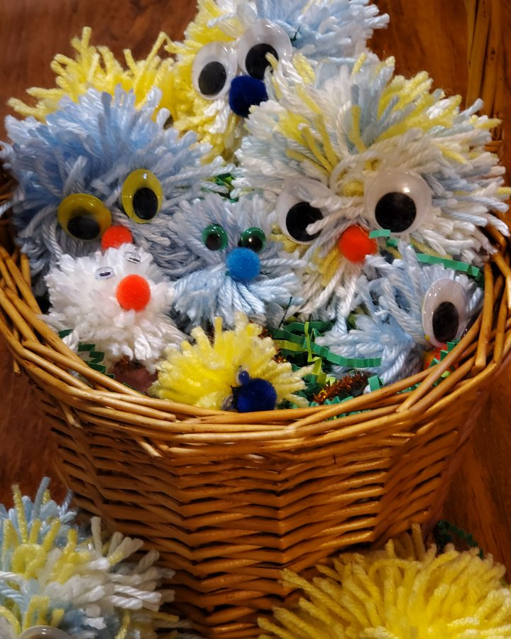 pom pom chicks in a basket