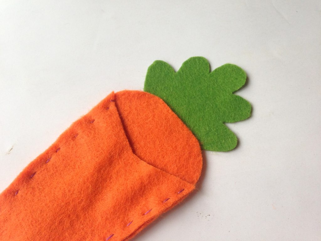Green top glued on carrot